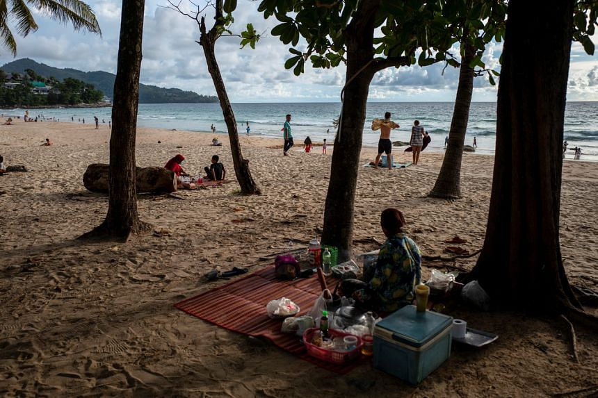 People at a beach in Phuket, on Sept 19, 2021. The island successfully reopened to vaccinated visitors in a pilot scheme.