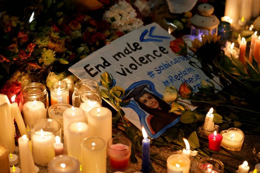 Well-wishers light candles amidst floral tributes during a vigil for Sabina Nessa, in south-east London, on Sept 24, 2021.