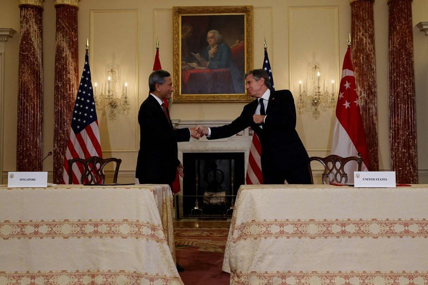 Singapore's Foreign Minister Vivian Balakrishnan (left) shakes hands with US Secretary of State Antony Blinken at the State Department in Washington on Sept 27, 2021.