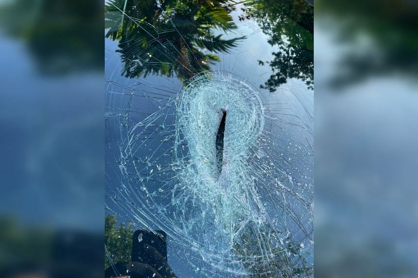 From the damage, the car owner suspects that an axe was used to hit the windscreen.