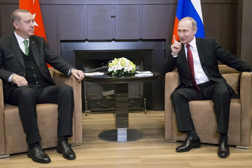 Russian President Vladimir Putin (right) meets with his Turkish counterpart Tayyip Erdogan in Sochi, Russia, on May 3, 2017.