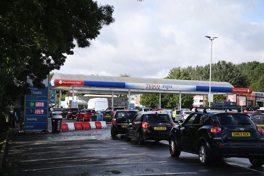 Cars queue at a Tesco petrol station in Friern Barnet in London, on Sept 27, 2021.