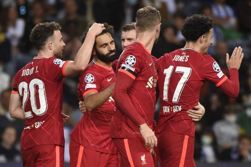 Liverpool's Mohamed Salah (second left) celebrates scoring his team's second goal with teammates.