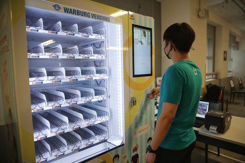 Beep Technologies CEO Kristoffer Jacek Soh Zhi Wei demonstrating the use of the ART vending machines at Mount Elizabeth Novena Hospital on Sept 23, 2021.