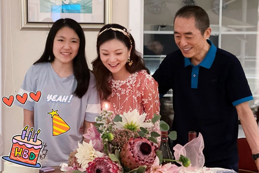 Chinese director Zhang Yimou and his wife Chen Ting (centre), with their daughter Yijiao (left).