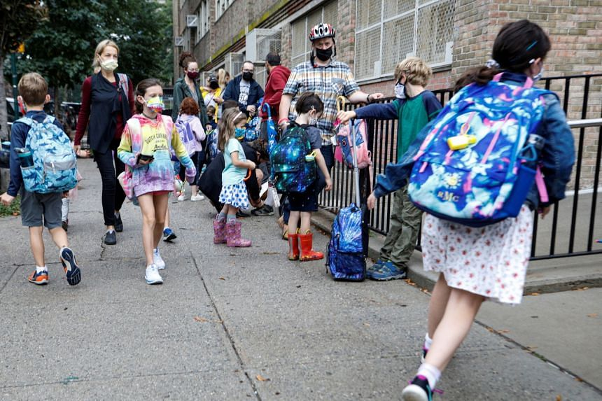 Children arrive at school in Brooklyn, New York, on Oct 4, 2021.