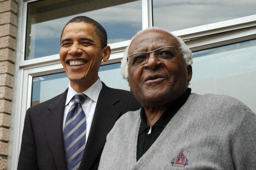 Former US President Barack Obama (left) and Desmond Tutu in a file photo taken in 2006.