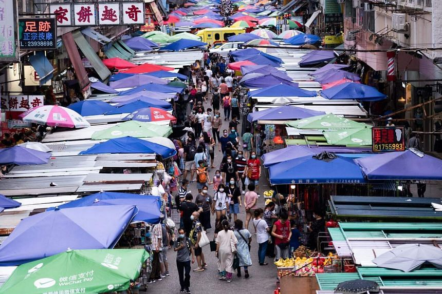 People at an outdoor market in Hong Kong's Mong Kok, on July 31, 2021.