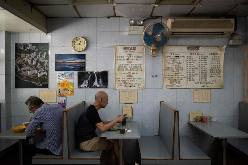 Customers have their meal at a local restaurant in Hong Kong, on Sept 4, 2021.