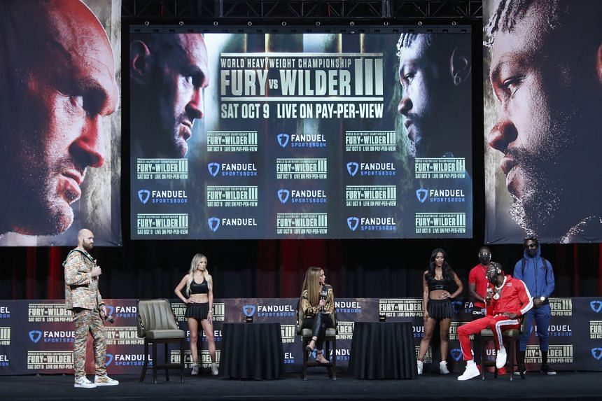 Tyson Fury (far left) and Deontay Wilder (far right) during the press conference on Oct 6, 2021.