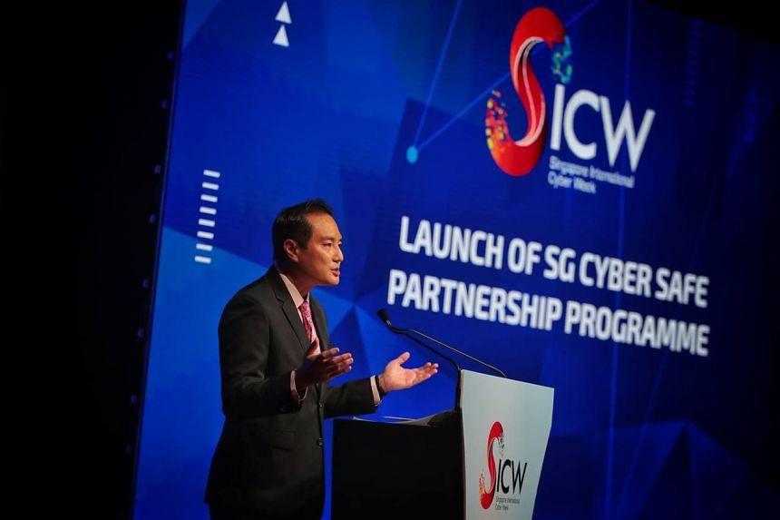 Mr Tan Kiat How speaking at the SG Cyber Safe Partnership Programme launch at Singapore International Cyber Week, on Oct 7, 2021.