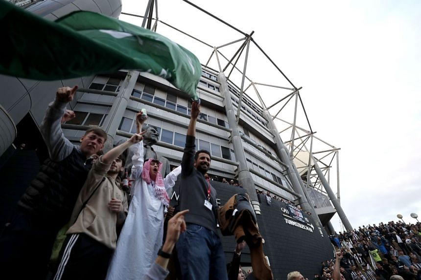 Fans react outside the stadium after Newcastle United announced the takeover.