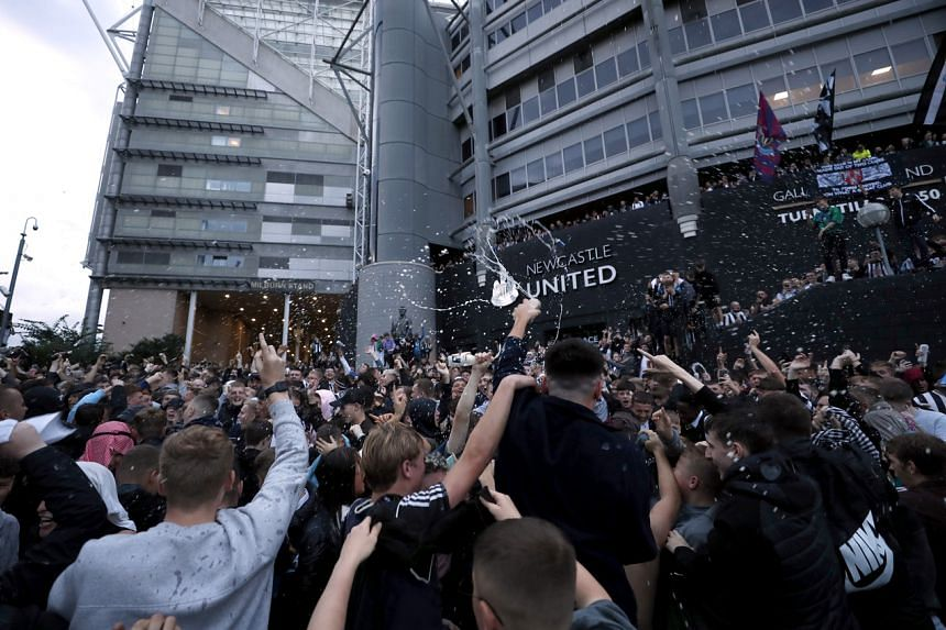 Fans react outside the stadium after Newcastle United announced takeover on Oct 7, 2021.