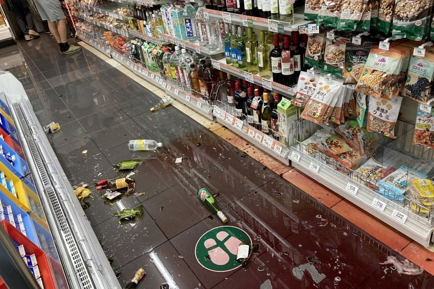 Damage at a store is seen following an earthquake in Tokyo on Oct 7, 2021.