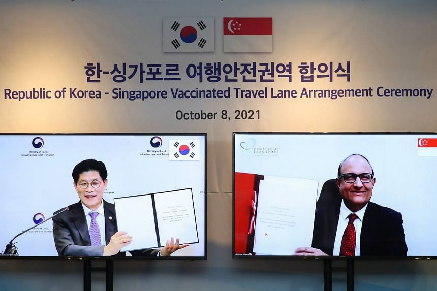 Minister for Transport S Iswaran (right) and South Korea's Minister of Land, Infrastructure and Transport Noh Hyeong-ouk after signing the VTL agreement on Oct 8, 2021.