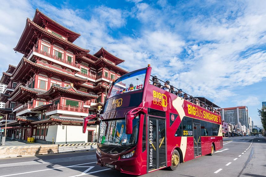 The open-top Big Bus tour near the Buddha Tooth Relic Temple in Chinatown.