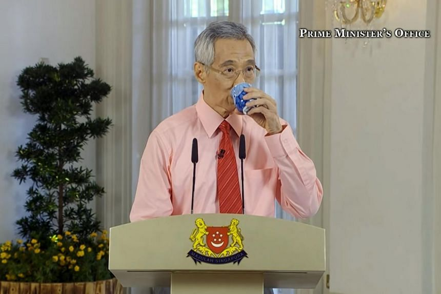 The magic cup is often on PM Lee's left as he speaks. A sip later, and he changes language.