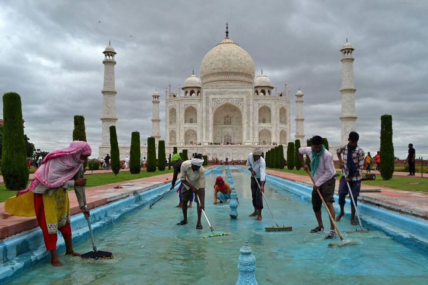 Workers cleaning a water fountain tank at the Taj Mahal in India on Sept 15, 2021.