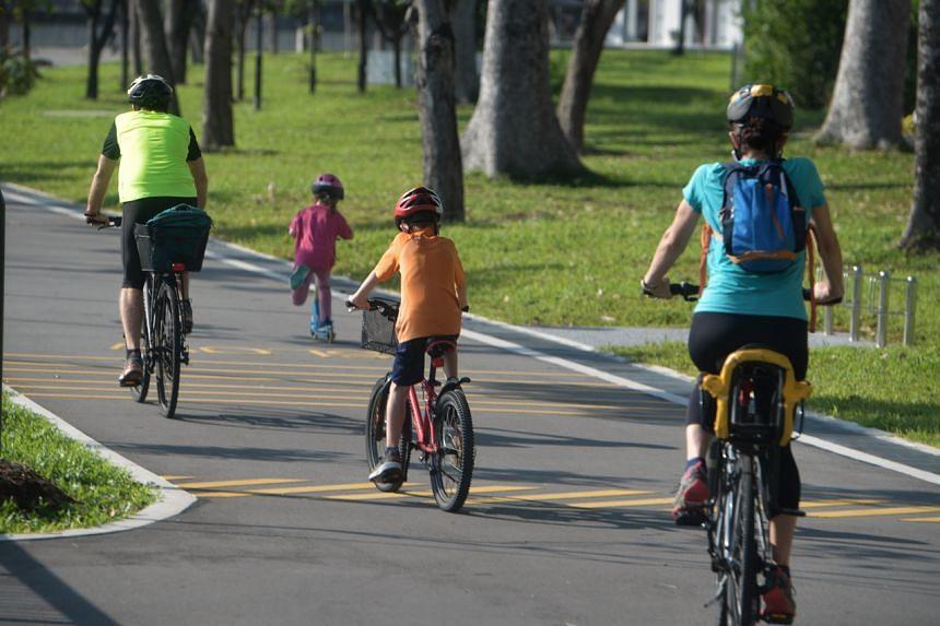 A family cycles along the Kallang Park Connector on April 15, 2020.
