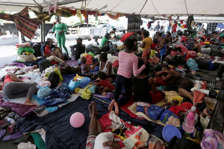 Haitian migrants seeking refuge in the US wait to be processed, in Monterrey, Mexico, on Oct 4, 2021.