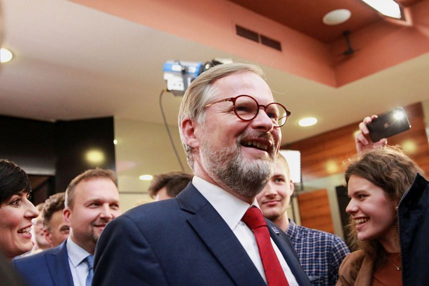 Together leader Petr Fiala, a former political science lecturer and university rector, reacts to the results of the country's parliamentary election, in Prague, on Oct 9, 2021.