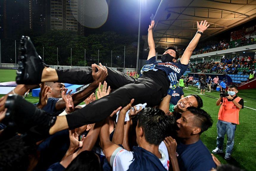 Lion City Sailors' coach Kim Do-hoon and his team celebrating their win against Balestier Khalsa during Singapore Premier League season finale at Jalan Besar Stadium on Oct 10, 2021.