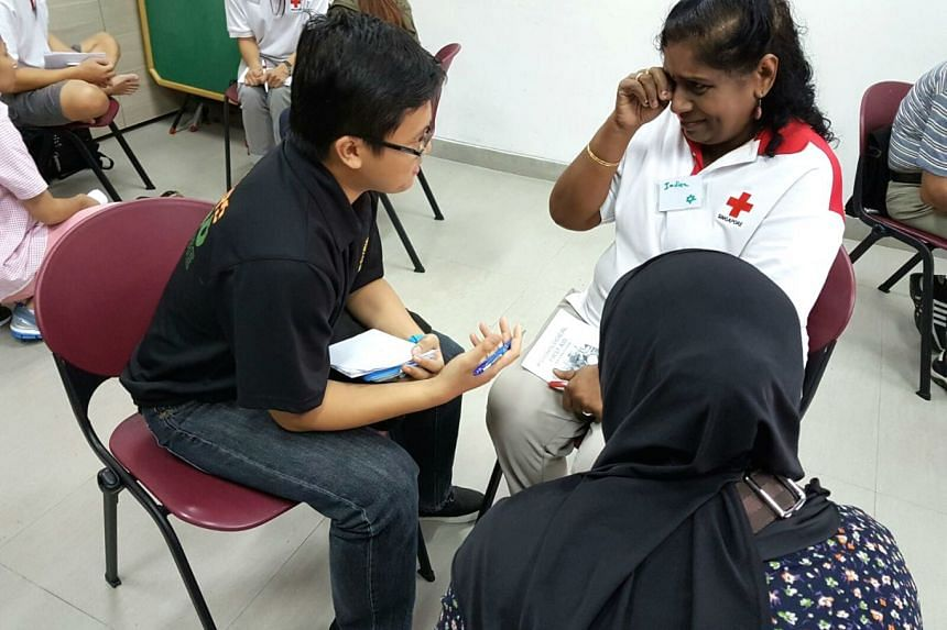 A Singapore Red Cross' psychological first aid class being conducted before Covid-19 restrictions were imposed.