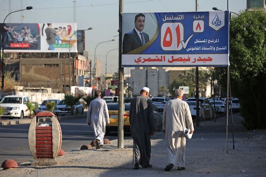 A campaign poster in Baghdad on Sept 14, 2021, ahead of the election.