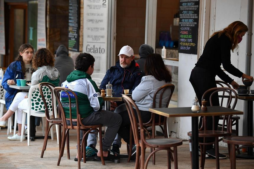 People dining at a cafe after nearly four months of lockdown in Sydney, on Oct 11, 2021.
