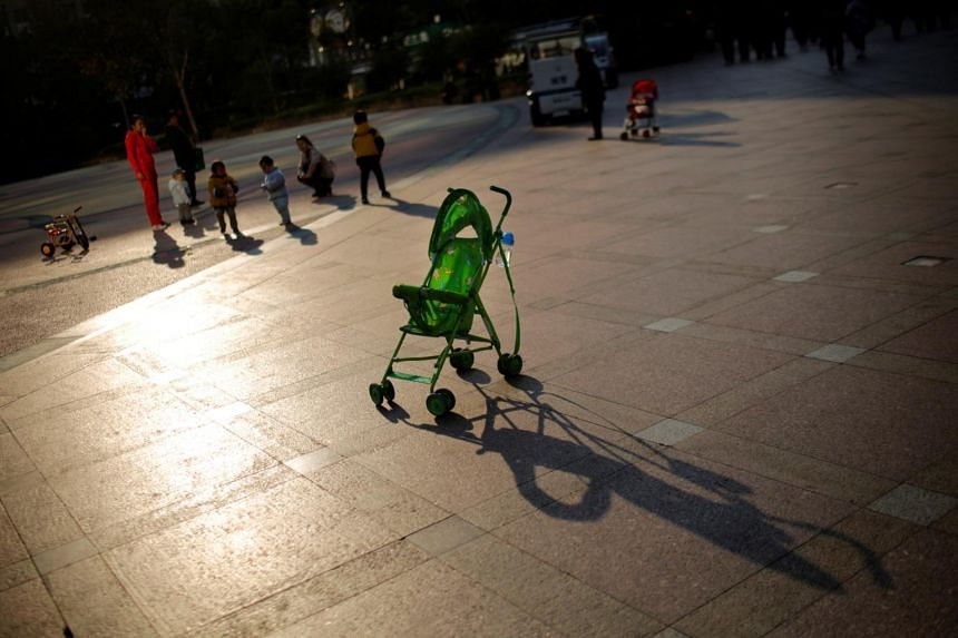Mothers playing with their children in Shanghai in a 2013 file photo. In China, courts rarely grant joint physical custody.
