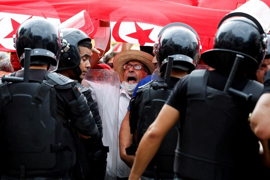 A demonstrator shouts slogans during a protest against Tunisian President Kais Saied's seizure of governing powers, in Tunis, on Sept 26, 2021.