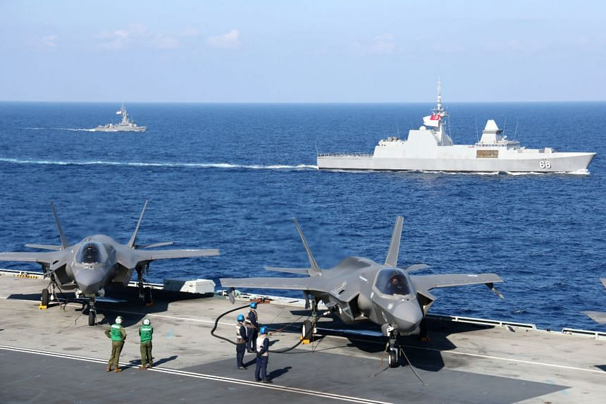 F-35Bs on HMS Queen Elizabeth, with the RSS Formidable and RSS Vigour in the background.