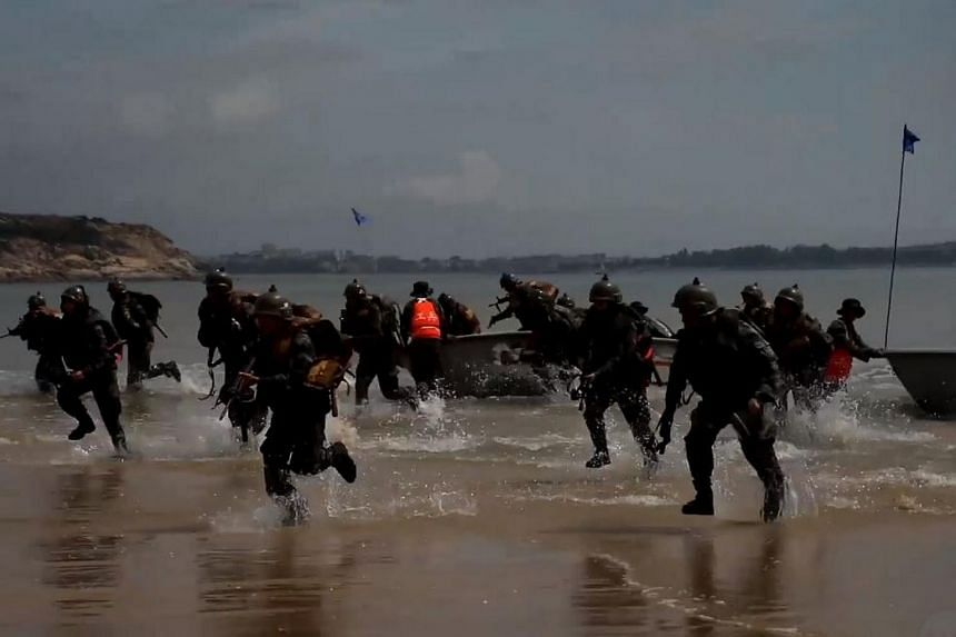 A video posted on the official People's Liberation Army Daily's Weibo account showed soldiers storming a beach, breaking through barbed wire defences and digging trenches in the sand.