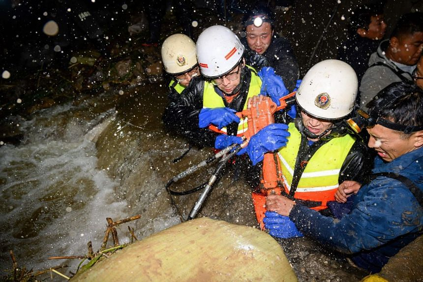 Rescuers drawing water at a flooded area after heavy rainfalls in Jinzhong city, Jiexiu, China's northern Shanxi province, on Oct 10, 2021.