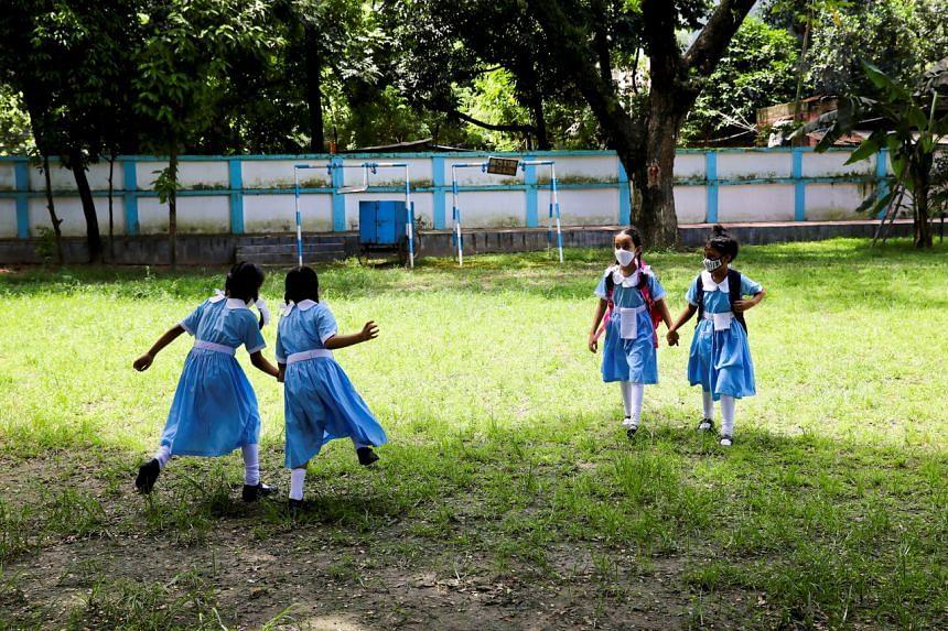 Students walk in the premises at the Viqarunnisa Noon School in Dhaka, Bangladesh, on Sept 12, 2021.