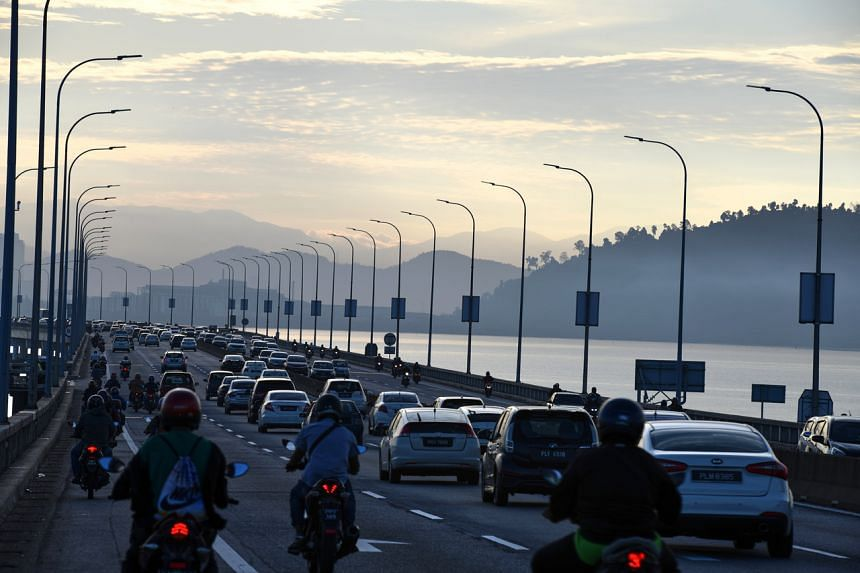 Vehicles at Penang Bridge on Oct 11, 2021. Inter-state travel has been allowed again in Malaysia after being banned for nine months.