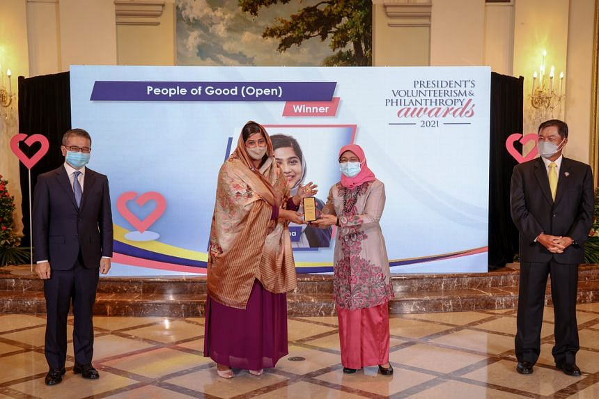 Ms Nazhath Faheema and President Halimah Yacob at the President's Volunteerism and Philanthropy Awards at the Istana on Oct 11, 2021.
