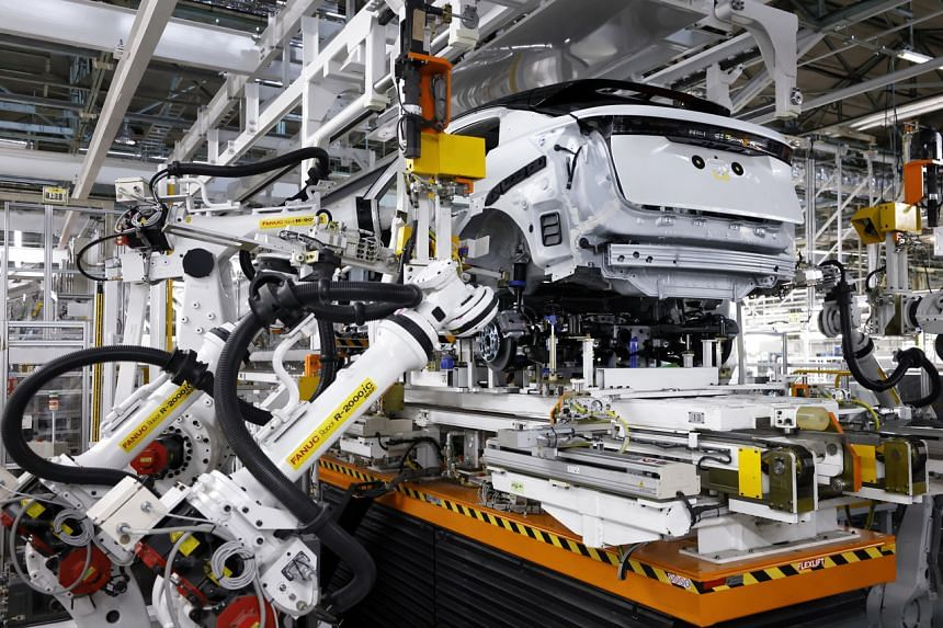 Nissan's Ariya electric crossover SUV being assembled by robots at the firm's plant in Kaminokawa on Oct 7, 2021. Nissan will electrify all plant equipment with renewables and fuel cells, as part of a broader plan to achieve carbon neutrality across