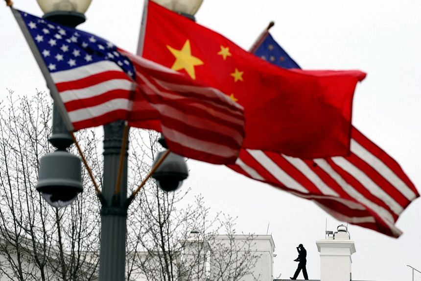 Chinese and US national flags flutter on a lamppost in Washington, DC on Jan 17, 2011.