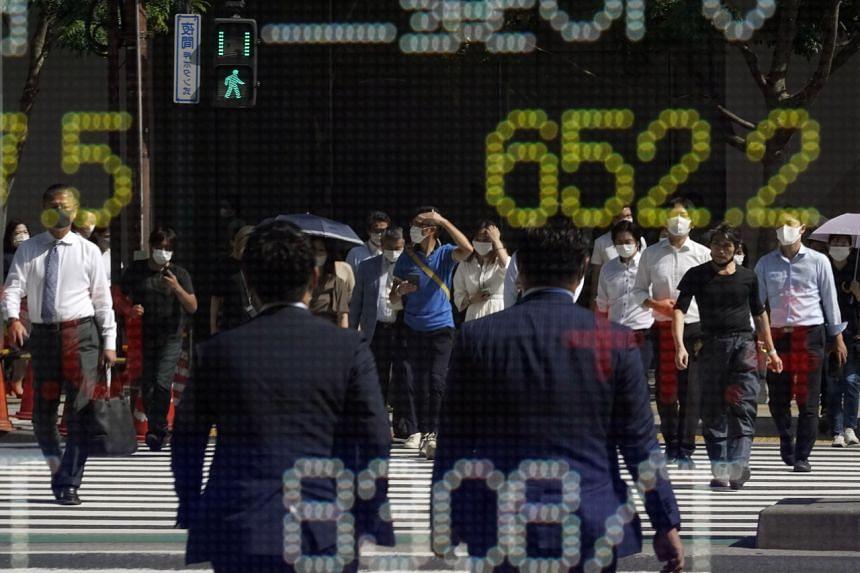 Japan's Nikkei stock index slid 1.03 per cent.