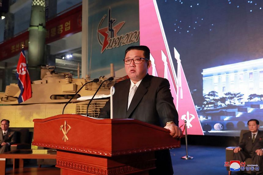 Mr Kim Jong Un giving a speech during a defence exhibition in Pyongyang on Oct 11, with the country's missiles on display next to him.
