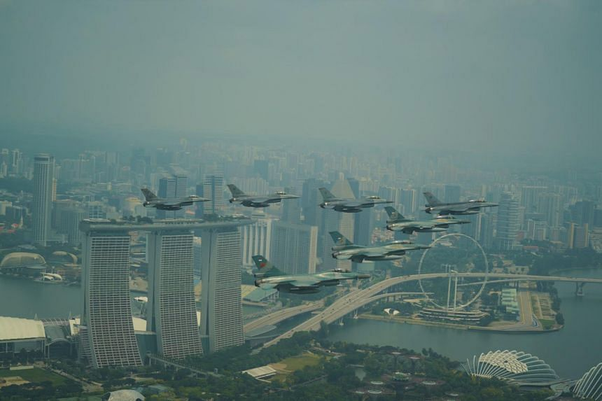 F-16 aircraft from the Republic of Singapore Air Force and the Indonesian Air Force flying in formation over Marina Bay Sands.