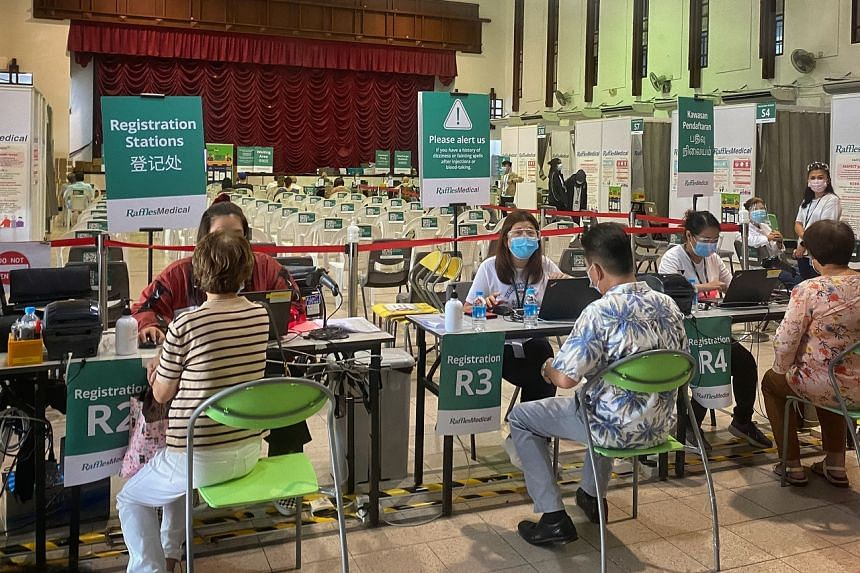 People at the vaccination centre at Tanjong Pagar Community Club on Oct 12, 2021.