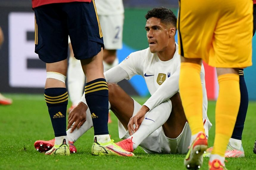France's Raphael Varane sustains an injury during the Nations League match against Spain, on Oct 10, 2021.