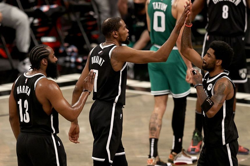 Kyrie Irving with his fellow superstar Brooklyn Nets teammates Kevin Durant and James Harden last season.