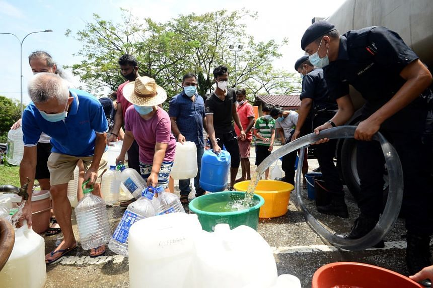 Residents of Puchong Jaya, Selangor, collecting water on Oct 5, 2020.