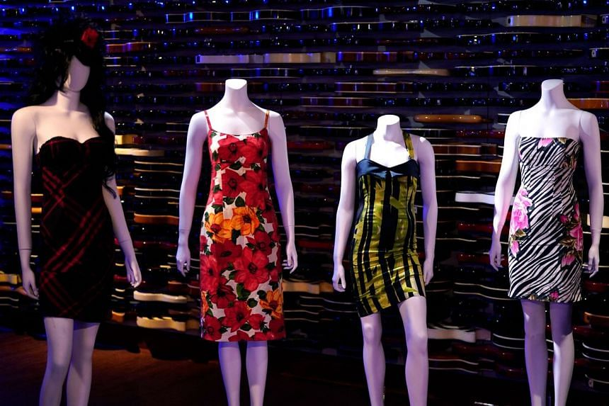 """Dresses displayed at the exhibition of the """"Property From The Life And Career Of Amy Winehouse"""" by Julien's Auctions in New York on Oct 11, 2021."""