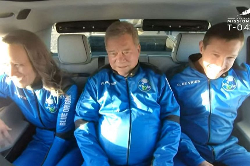 (From left) New Shepard NS-18 mission crew members Ms Audrey Powers, Mr William Shatner and Mr Glen de Vries, ride to the launch pad on Oct 13, 2021.