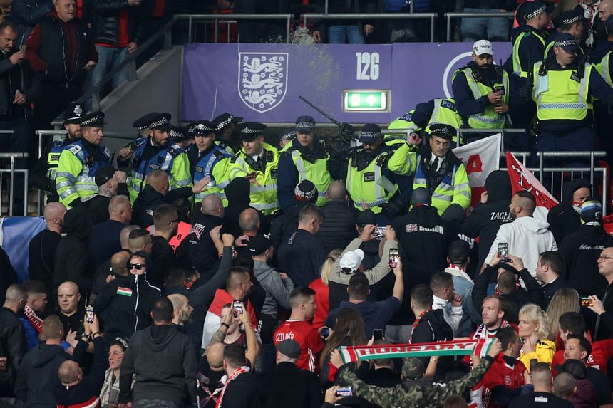 """Police came under attack from Hungary fans after they moved into the """"away"""" section and had to retreat."""