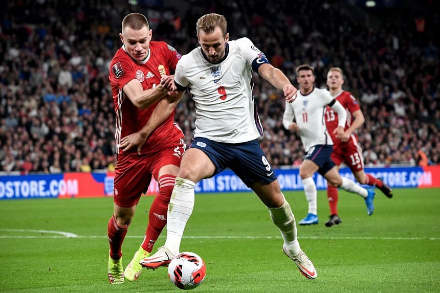 England's Harry Kane (right) in action against Hungary's Attila Szalai (left) at Wembley on Oct 12, 2021.